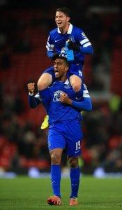 Distin celebrates their win at Man United in 2013 Photo: Simon Stacpoole / Offside.